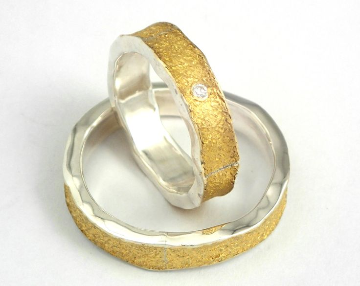 Modern gold and silver wedding rings with glossy silver and a rough 22K gold…
