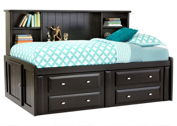 Our Catalina Full Roomsaver Bed expands your child's bedroom with a space-conscious contemporary styled full captain's bed with storage. The roomsaver headboard which runs the length of the bed offers a room extra space with unique styling while providing shelving space for books, alarm clock, nightlight and framed photos.The piece comes in a black cherry finish and features four drawers located underneath the bed that are perfect for keeping spare blankets, pillows and sweatshirts…