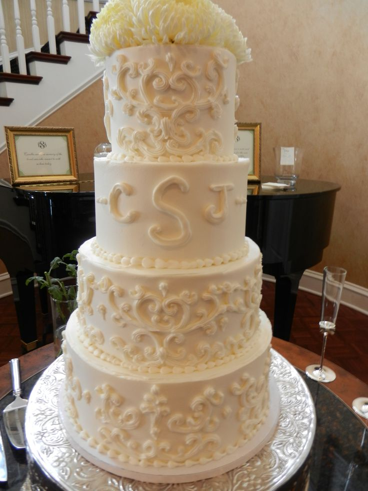 scrolled wedding cake with monogram wwwcheesecakeetcbiz wedding cakes charlotte nc