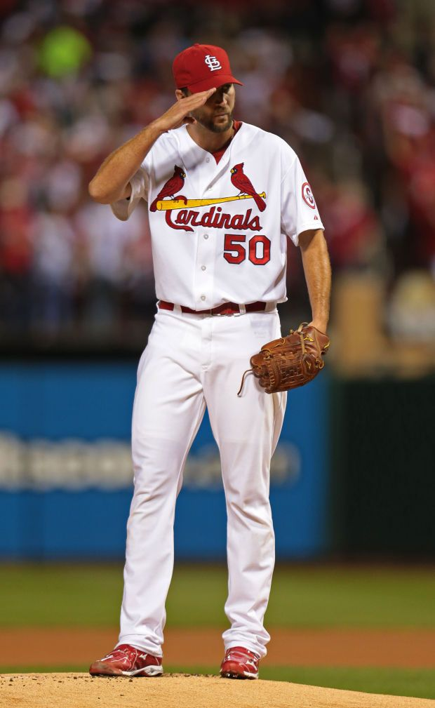 Adam Wainwright salutes Yadier Molina at start of Game 5 of the National League Division Series between the St. Louis Cardinals and the Pitt...