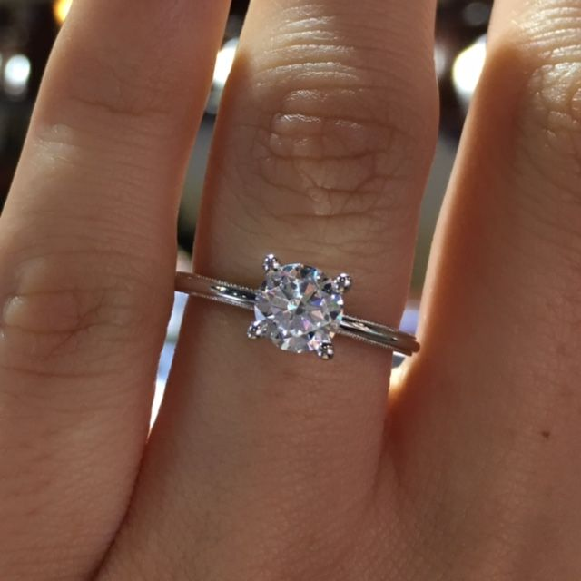 This Tacori Diamond Solitaire Engagement Ring Setting is from the Tacori Sculpted Crescent collection. This engagement ring can fit a Princess or Round shape center stone.