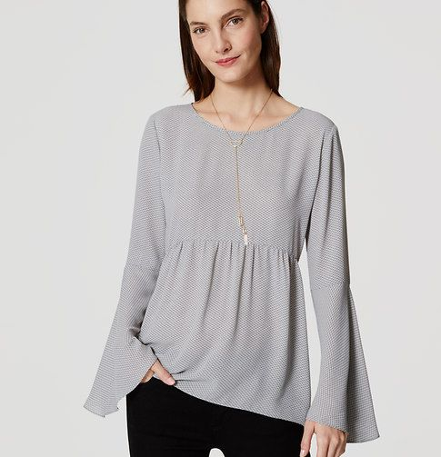 With bell sleeves and a peplum waist, this flowy blouse is a romance in and of…