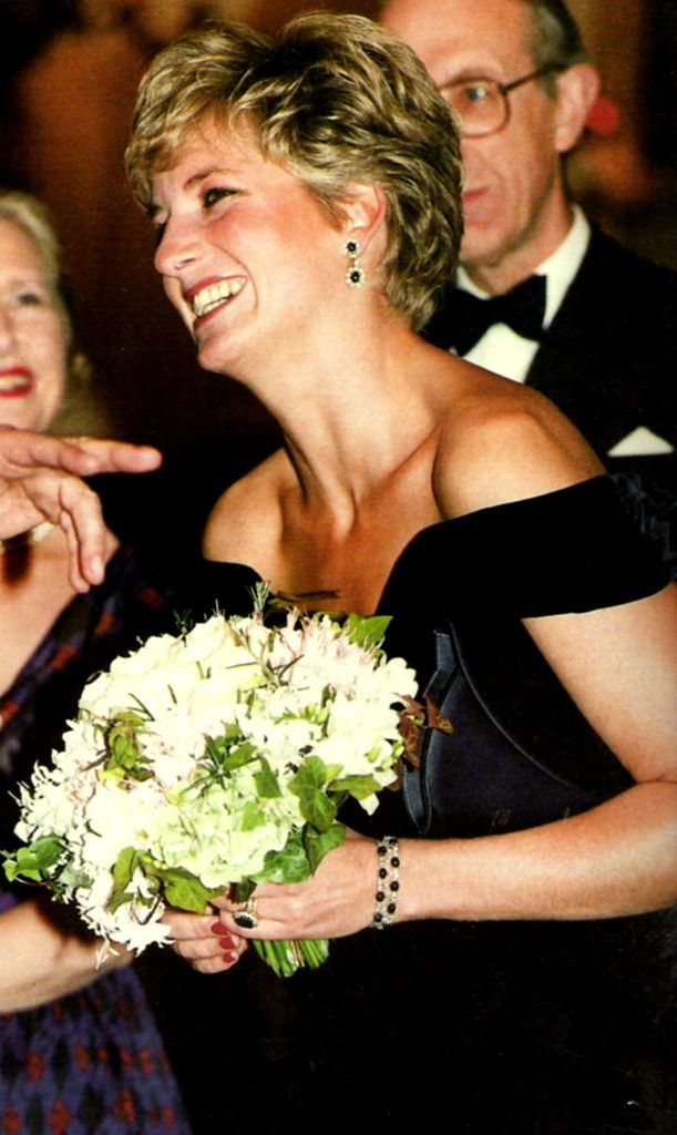 A big smile from Princess Diana to a funny guest, who she enjoyed a joke from!    Photographed during a charity gala, in 1993.