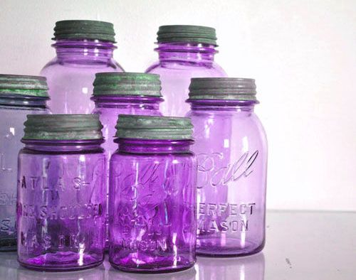 Purple Mason Jars....very, very nice! I can see lighting these up or not....maybe adding some type of floral or seashell arrangement with these for a nautical room. Would be great for a bathroom or girls room for this or that storage. :)