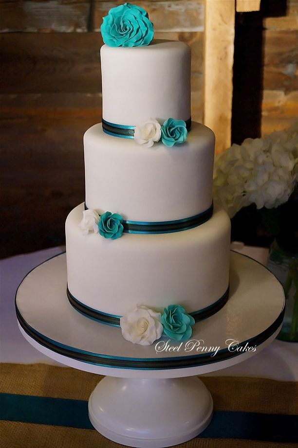 Teal+&+white+wedding+cake+-+Simple+and+classy+with+teal+and+white+roses.