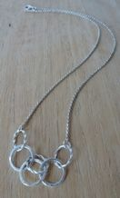 chain necklace with battered and twisted wire hoop detail