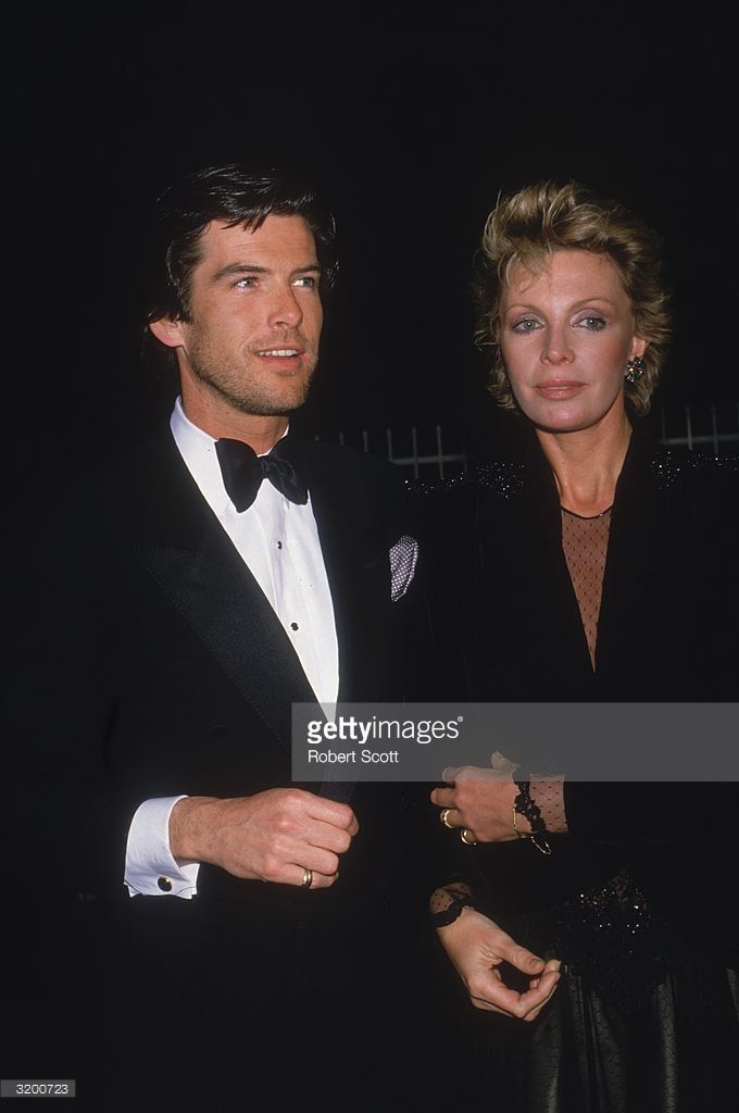 Actor Pierce Brosnan and his wife Cassandra Harris in formal attire attend the 11th Annual People's Choice Awards on March 14, 1985.