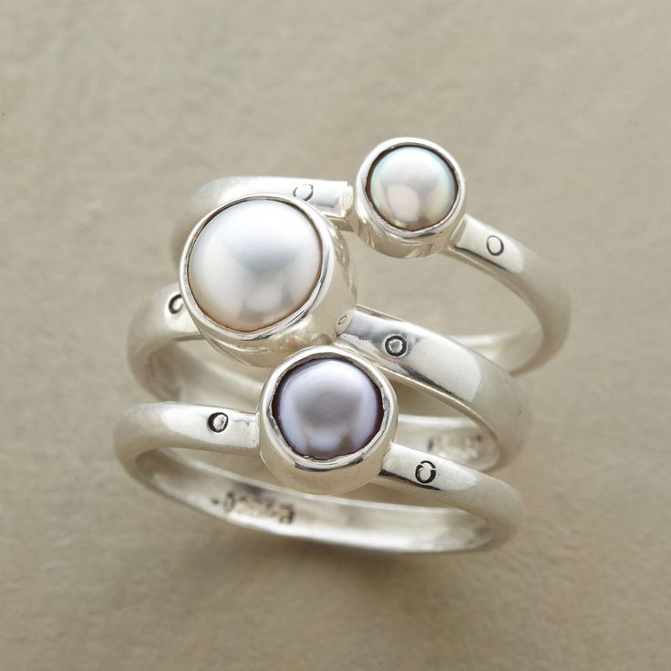 PEARL SISTERS RING TRIO--White, gray and peacock cultured pearls, one per band, share a family resemblance, but each in this pearl sisters ring trio is unique. Exclusive set of 3 handcrafted in sterling silver. Whole sizes 5 to 9.