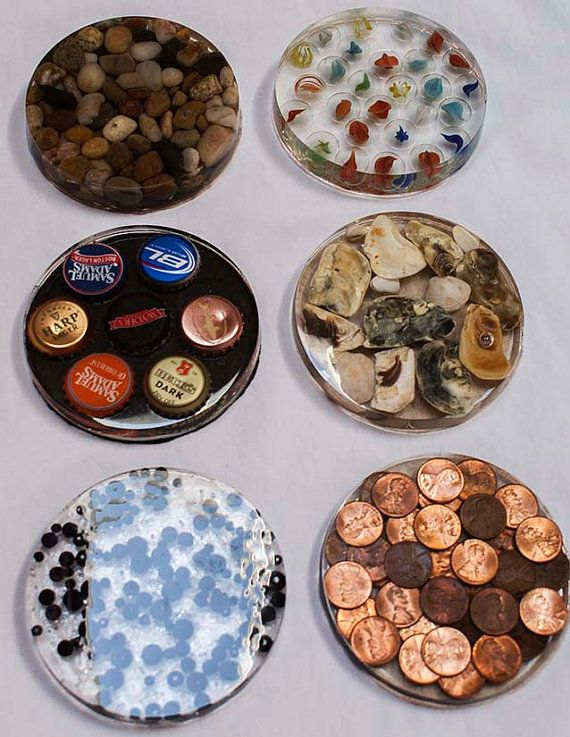 Epoxy coasters are 3.75 inches round and 1/2 inch thick. They come in a variety of styles, including beer bottle caps, pebbles, beads, and photos. I also can custom design a coaster set for you with a photo of your choice. Epoxy Coaster Set of 4 by Timeout4me on Etsy, $20.00.