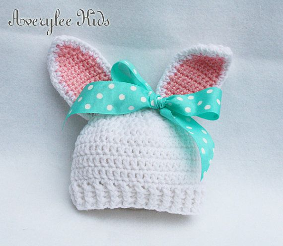 Our Bunny Hat is perfect for your babys first photo! The bunny ears are crocheted with sweet pink ears and then a cheery bow with white polka dots