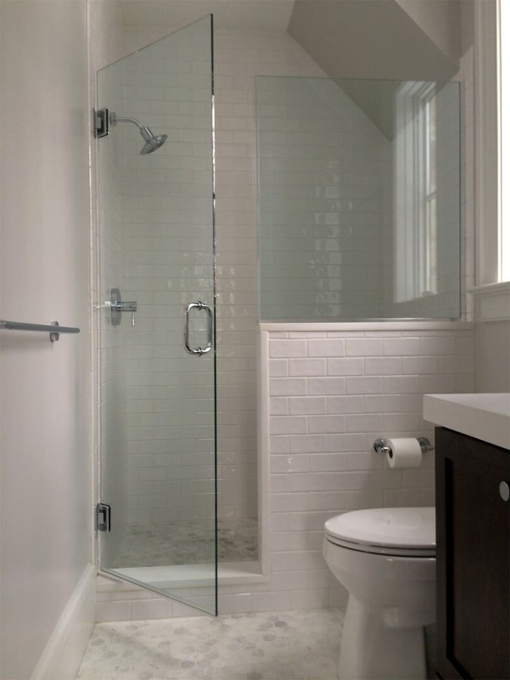 frameless shower glass with half wall panel installed with