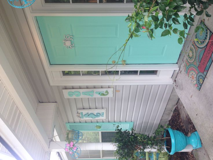 Turquoise   aqua beach house front door ideas - DIY mermaid house number sign - DIY beach house name sign with seahorse - cast iron crab door knocker painted white - Turquoise Front door and turquoise shutters painted with Pantone color systems Beach Glass. Turquoise, aqua, beach, beachy, blues and greens, coastal, scallop shells, exterior decorating ideas, exterior decor ideas