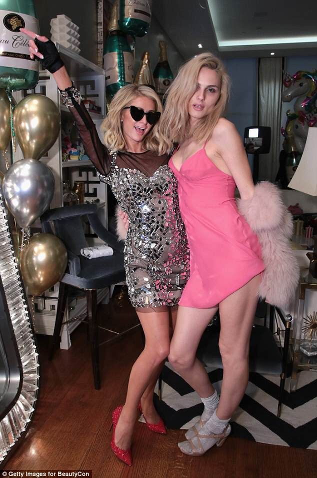 Animated: The star appeared in high spirits as she playfully posed withAndreja Pejic...