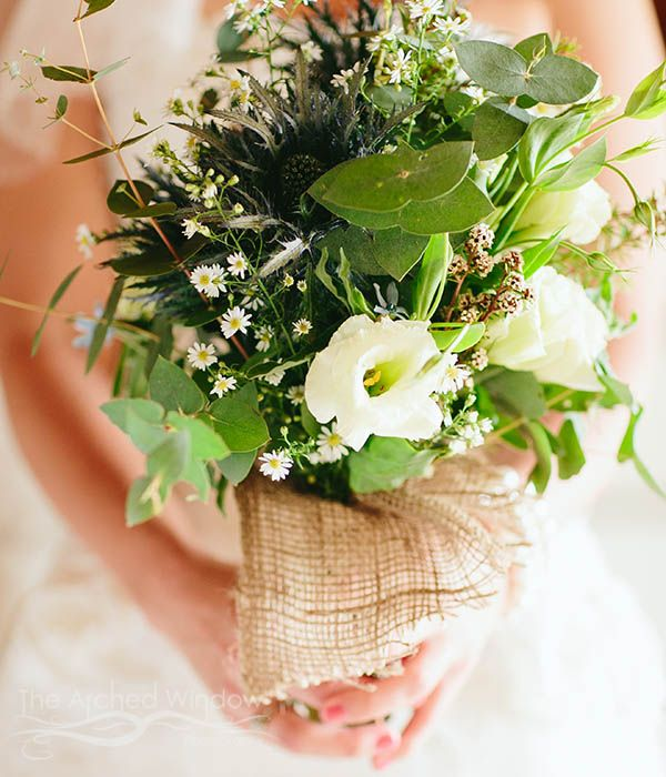 Native Australian flowers as a wedding bouquet. Wedding held at Peppers Ruffles Lodge and Spa, Gold Coast hinterland. Photography by Mt Tamborine wedding photographers The Arched Window. Flowers by Gold Coast Florist.