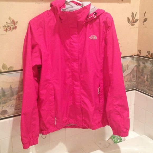 """North Face Rain jacket/ Windbreaker Pink north face I've had it for maybe a year so it's in good condition there's no rips. The only """"stains"""" are on the cuffs as shown and on the Velcro is but it'll probably come out in the wash. It's an Hyvent rains jacket/windbreaker. It has a fleece type fabric on the collar to help keep you warm and a mesh lining the inside. It also has synchs on the bottom hem and for the hood The North Face Jackets & Coats"""