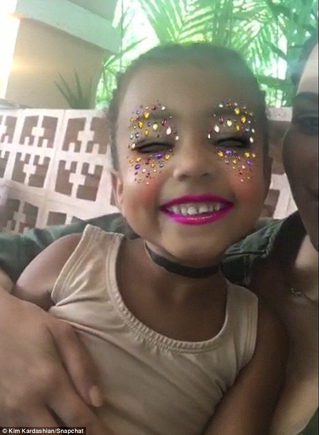 Virtual makeup: Kim Kardashain and daughter North West played virtual makeup in a Snapchat...