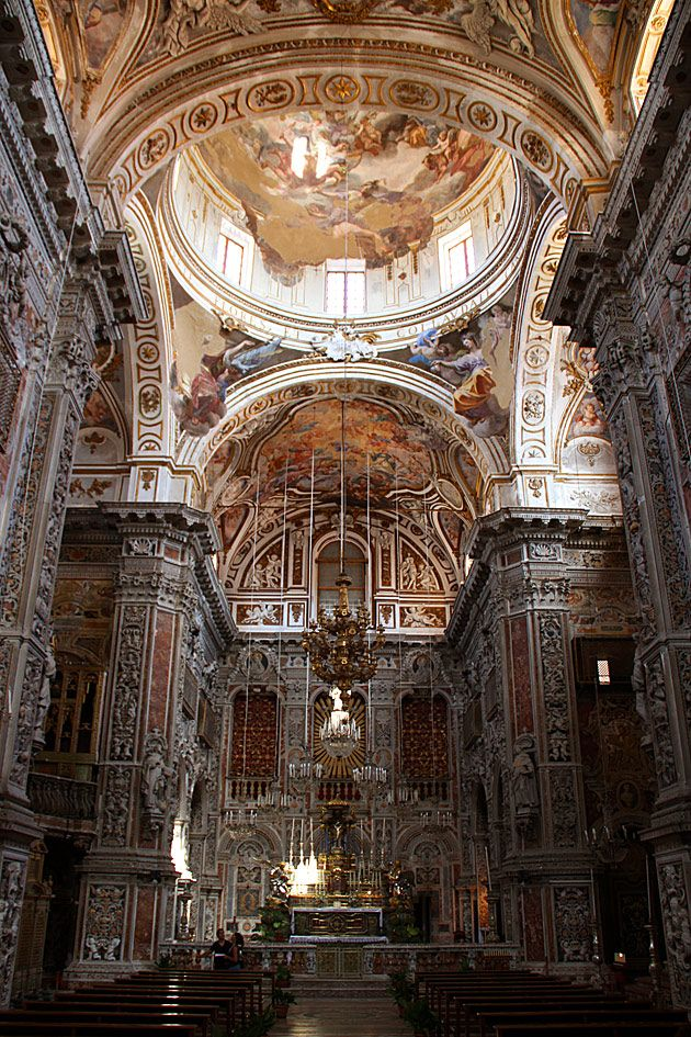 Santa Caterina, Palermo, Italy. Construction on the church began in 1566, but the interior decoration dates from the 17th and 18th centuries, when Baroque was at its height, and the Catholic church was encouraging intricate detail and emotional themes. The interior of the church is visually overwhelming. Richly colored frescoes spill out across the ceiling.