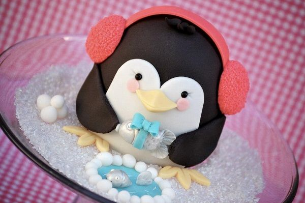 Penguin-Shaped Cake Wearing Earmuffs for Penguin awareness day by Royal Bakery and others