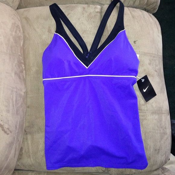 Nike purple tankini top Brand new. Never worn. Size 12. Got it as a gift but never worn it. Padded Bathing suit top (tankini). Still has its tag on. Willing to negotiate. I also do bundles.. 10% off on 2 or more items from my closet. Nike Swim