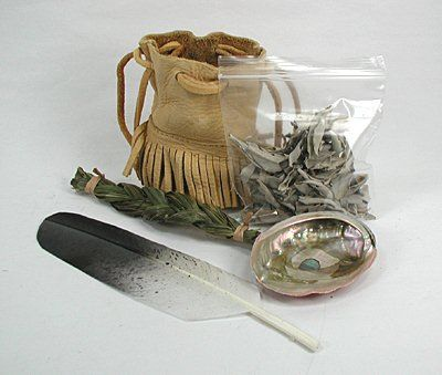 """Smudge Kit. The """"Sacred Smoke Bowl Blessing"""" is a powerful Native American cleansing technique. It is a ritual to remove negativity. Smoke attaches itself to the negative energy and removes it to another space. - The shell represents WATER - The unlit herbs and ashes represents the EARTH - The lit herb represents the FIRE - The smoke represents the AIR"""