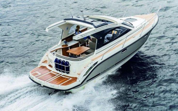 AQUADOR 30 SPORT-TOP Elektr. Bilgenpumpe, Teppich in Kabine, Kirschholz Interieur, Kompass, Cockpitkissen, elektr. Deckelheber, Defroster, zwei Batterien, Preis: CHF 240.000,- Bodenseezulassung:Ja Jahrgang:2015 Breite:3.10 m Angebot:Neuboote, Vorführboote Länge:9.15 m Typ:Kabinenboot, Sportboot, Hardtop