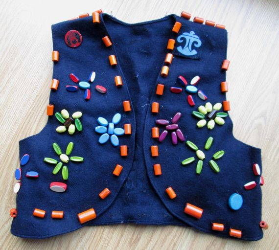 Campfire Girls ... wo-he-lo. I was a campfire girl and had this blue felt vest. Instead of badges, we would earn beads and sew them onto our vest. The beads all meant something different.