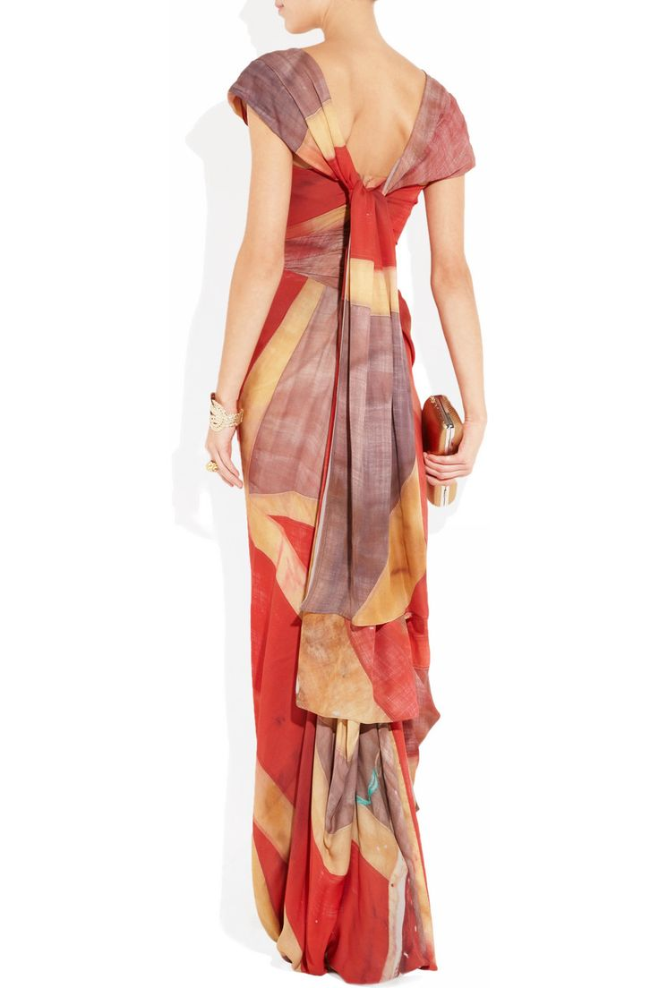 """rear view - Vivienne Westwood Gold Label's vintage-inspired silk-georgette """"draped-in-the-flag"""" gown in her signature corseted design is elegantly draped and ruched to help shape a feminine silhouette makes a beautifully patriotic statement emblazoned with the Union Jack  