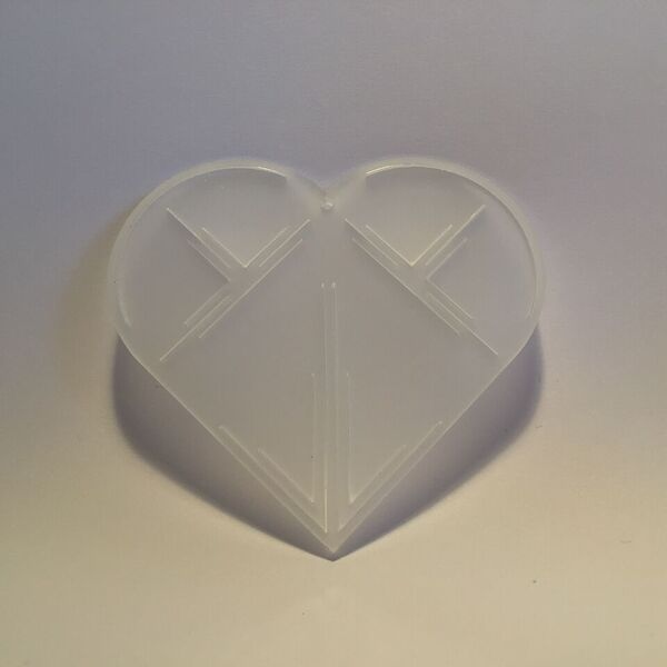 Milkwhite plexiglass christmas heart ornament. Designed and produced in Copenhagen.