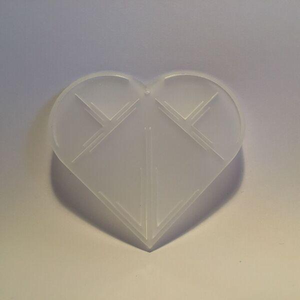 Milkwhite plexiglass christmas heart ornament. Designed and produced in Copenhagen.