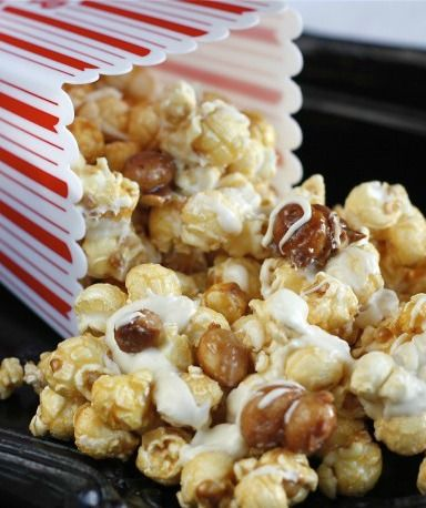 Perfect for your next family movie night or as a snack to set out at a party, this White Chocolate Candied Macadamia Nut Cracker Jacks recipe is the perfect balance of salty and sweet. You'll make your own caramel popcorn, candy some macadamia nuts and then drizzle the irresistible combo with decadent white chocolate. It's so yummy!