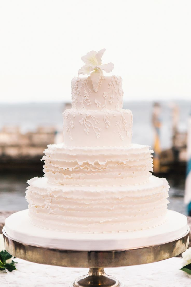 White #wedding cake with ruffles by Ana Paz, image by Vue Photography. #wedding