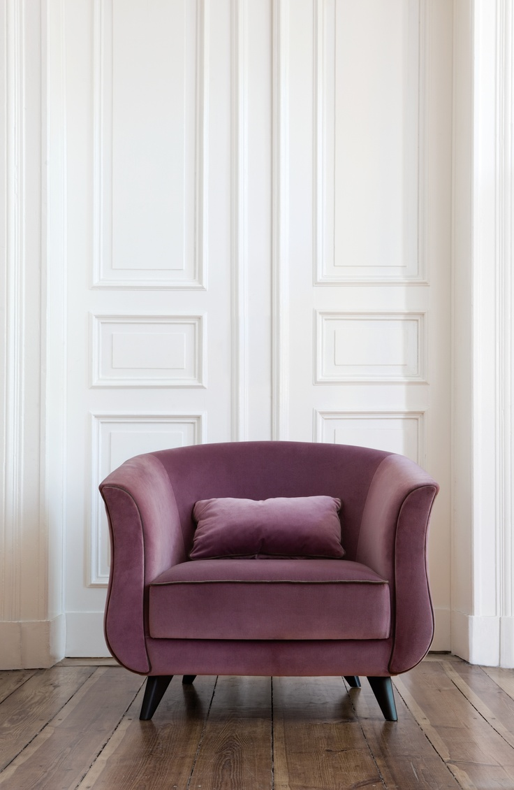 The Kaczka is a beautiful armchair, the lines accentuated by the decorative stitching along the edges reveal the full beauty of its shape.......