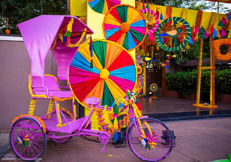 Colorful Tricycle For A Mela Themed Mehndi Party Decor