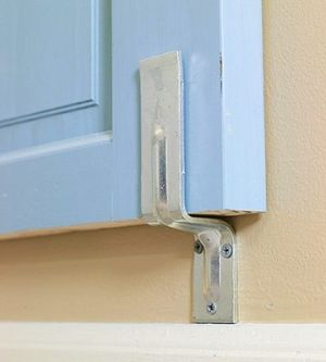 How to install wall braced headboard: Locate two wall studs using a stud finder. Screw two bar holder brackets into the studs flush with by jenniferET