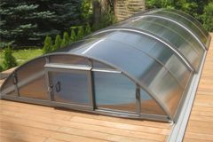 Albixon Infinity - Low profile telescopic tracked and trackless swimming pool enclosures pool covers pool dome for the UK market - Leisure Shelters UK Ltd