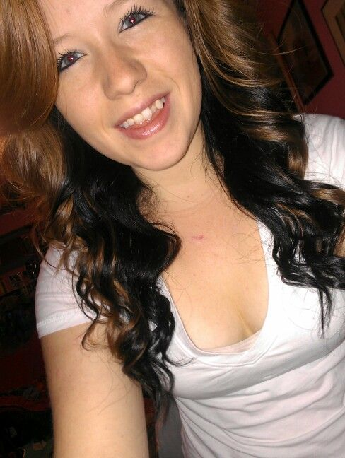 Natural red hair with black dyed underneath. Super curled ...