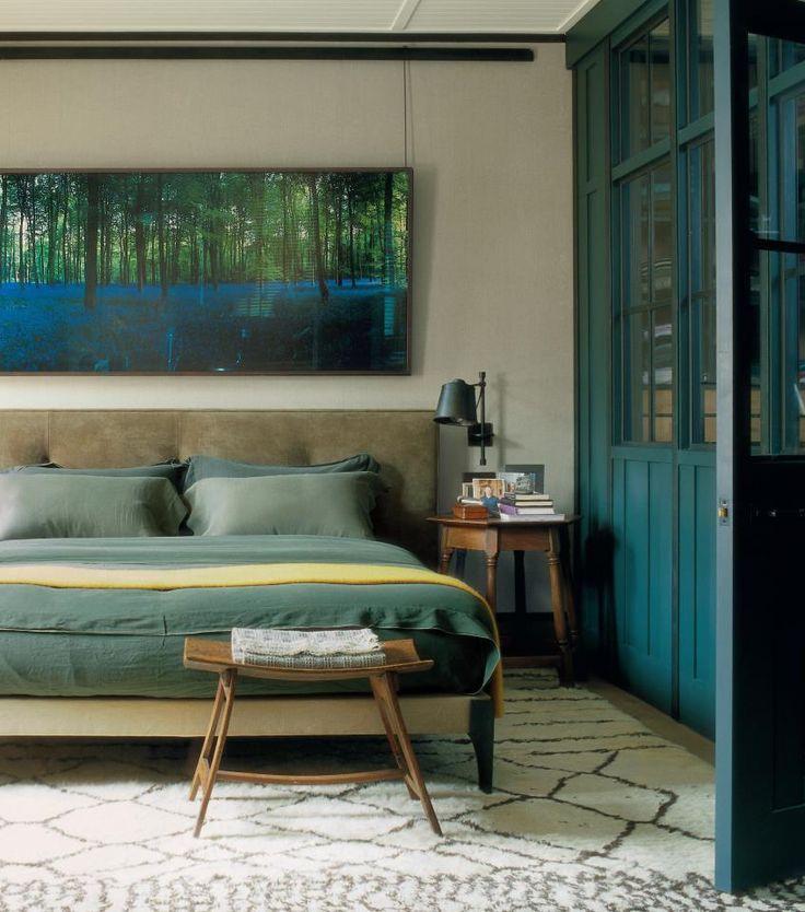 Worn shades of green and blue blend together to create calm and serenity in this gorgeous bedroom. Jonathan Reed - Cover World of Interiors magazine.
