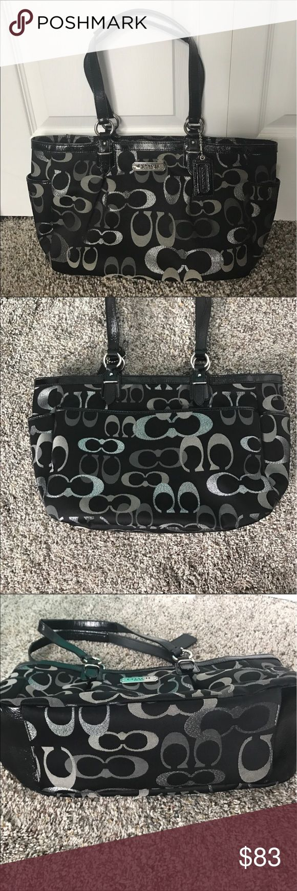 Coach tote bag Coach tote bag. Black with gray and silver glittery C's. Only carried a few times. Like new condition. Approximately 14 inches length at bottom, 16 inches length at top, and about 9 inches height. Has two outside side pockets, and one large outside back pocket...perfect for a cellphone or even a planner. It also has one zipper pocket and two slip pockets inside. Zips to close at top. Coach Bags Totes