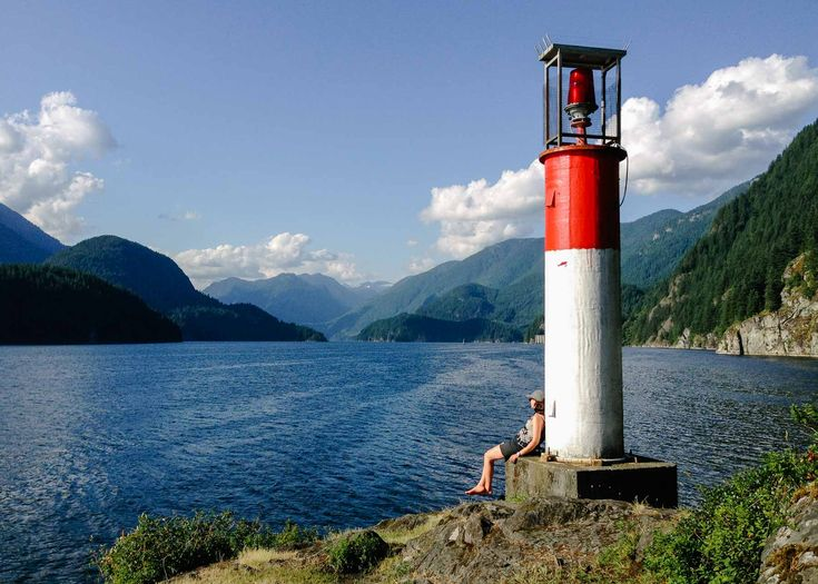 Twin Island lighthouse with a mountain view up Indian Arm