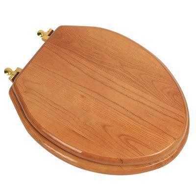 PlumbingTechnologiesLLC Designer Solid Oak Wood Elongated Toilet Seat Finish: Natural Red Oak, Hinge Finish: Polished Brass