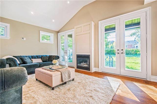 Elegant family room overlooking backyard through oversized patio doors