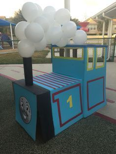 Thomas the train made out of cardboard boxes for a Halloween or birthday party.