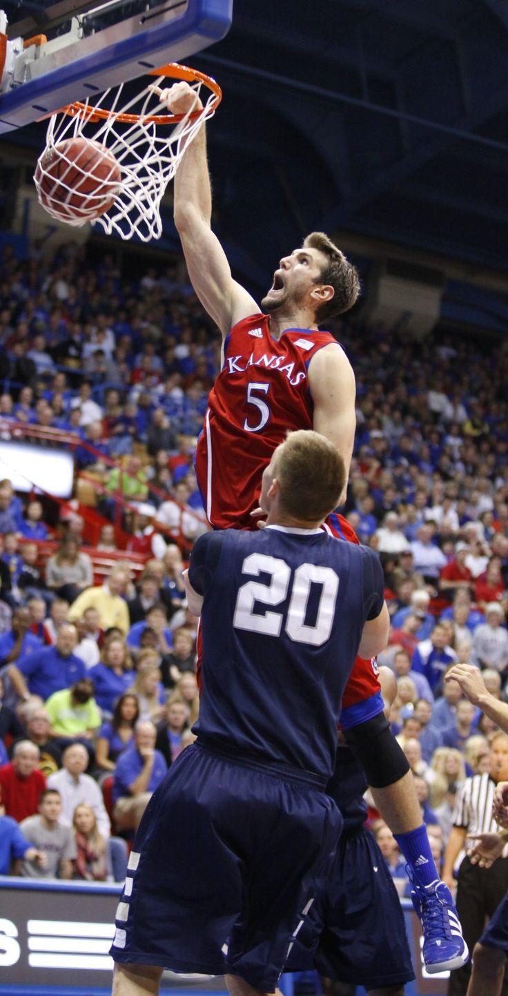 Kansas center Jeff Withey dunks as Washburn forward Bobby
