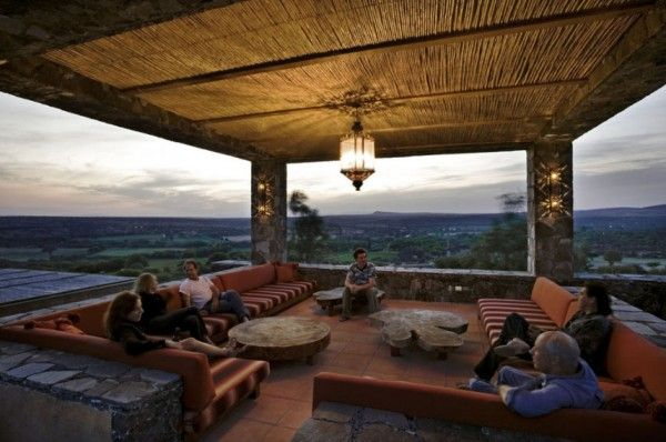 """Exceptional Spanish-style hacienda in Mexico. This is the """"Margarita Lounge"""" located off the master bedroom, with a concrete roof and thatched ceiling."""