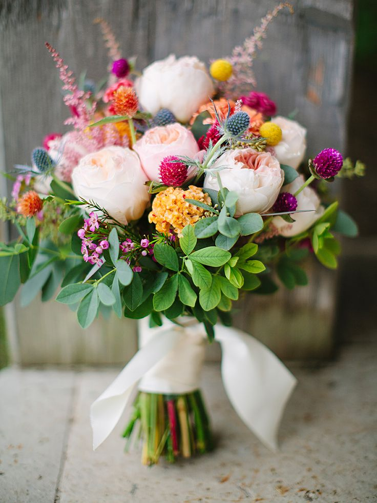 For a bright and charming wildflower wedding bouquet, accent your colorful blooms with thistle and gomphrena for combination guaranteed to catch anyone's attention.
