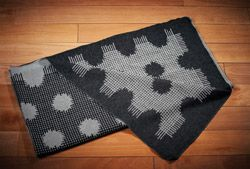 """Keep warm w/chic 'Moth Throw' for $5! This dotted blanket will be raffled @ our ArtAuction this FRIDAY! Raising funds for the homeless in Toronto. Material: jacquard woven: 65% cotton, 28% alpaca, 12% bamboo, size: 57"""" x 56"""""""