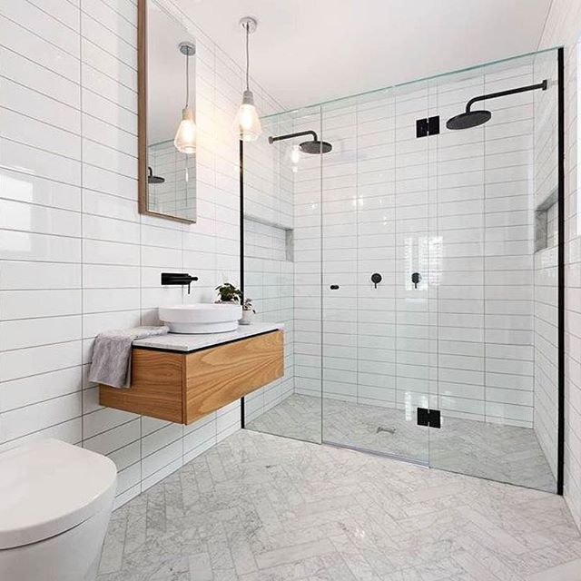 Now that's a shower! And that adorable little floating vanity topped with Caesarstone from Panorama Cabinets ・・・ Our wood veneer floating vanity is the perfect feature for this modern white bathroom. Looks great with the black tapwear