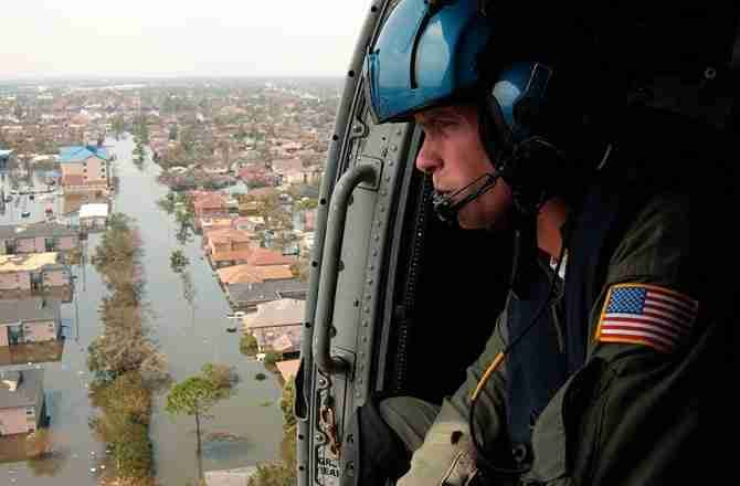 A Coast Guard officer looks for survivors in the wake of Hurricane Katrina. | NyxoLyno Cangemi/U.S. Coast Guard/Corbis