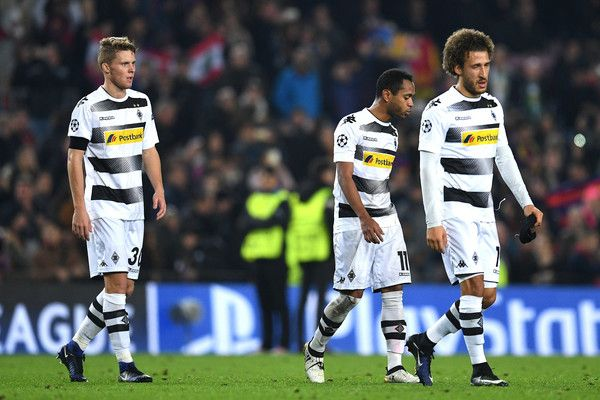 Nico Elvedi of Borussia Moenchengladbach (L), Raffael of Borussia Moenchengladbach (C) and Fabian Johnson of Borussia Moenchengladbach (R) are djected after the final whistle during the UEFA Champions League Group C match between FC Barcelona and VfL Borussia Moenchengladbach at Camp Nou on December 6, 2016 in Barcelona.