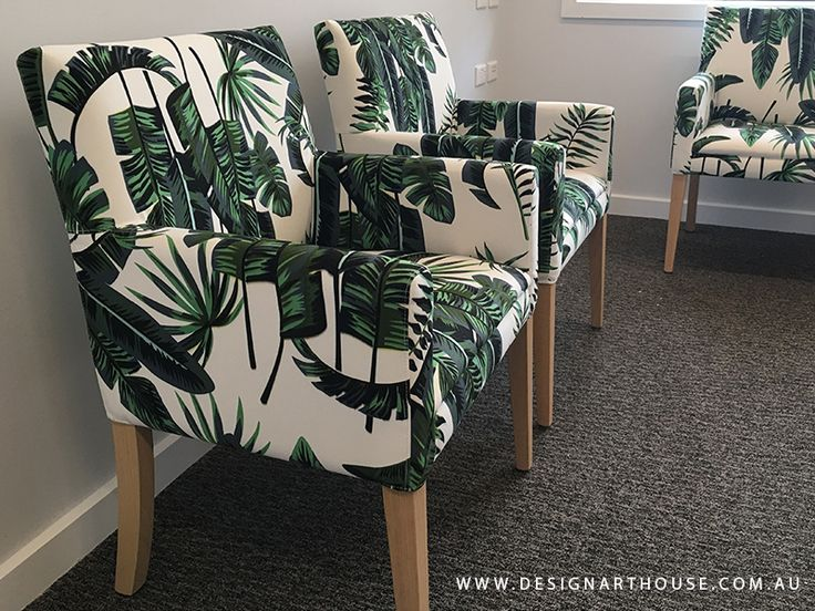 Custom made upholstered occasional armchair in green leaf pattern fabric.